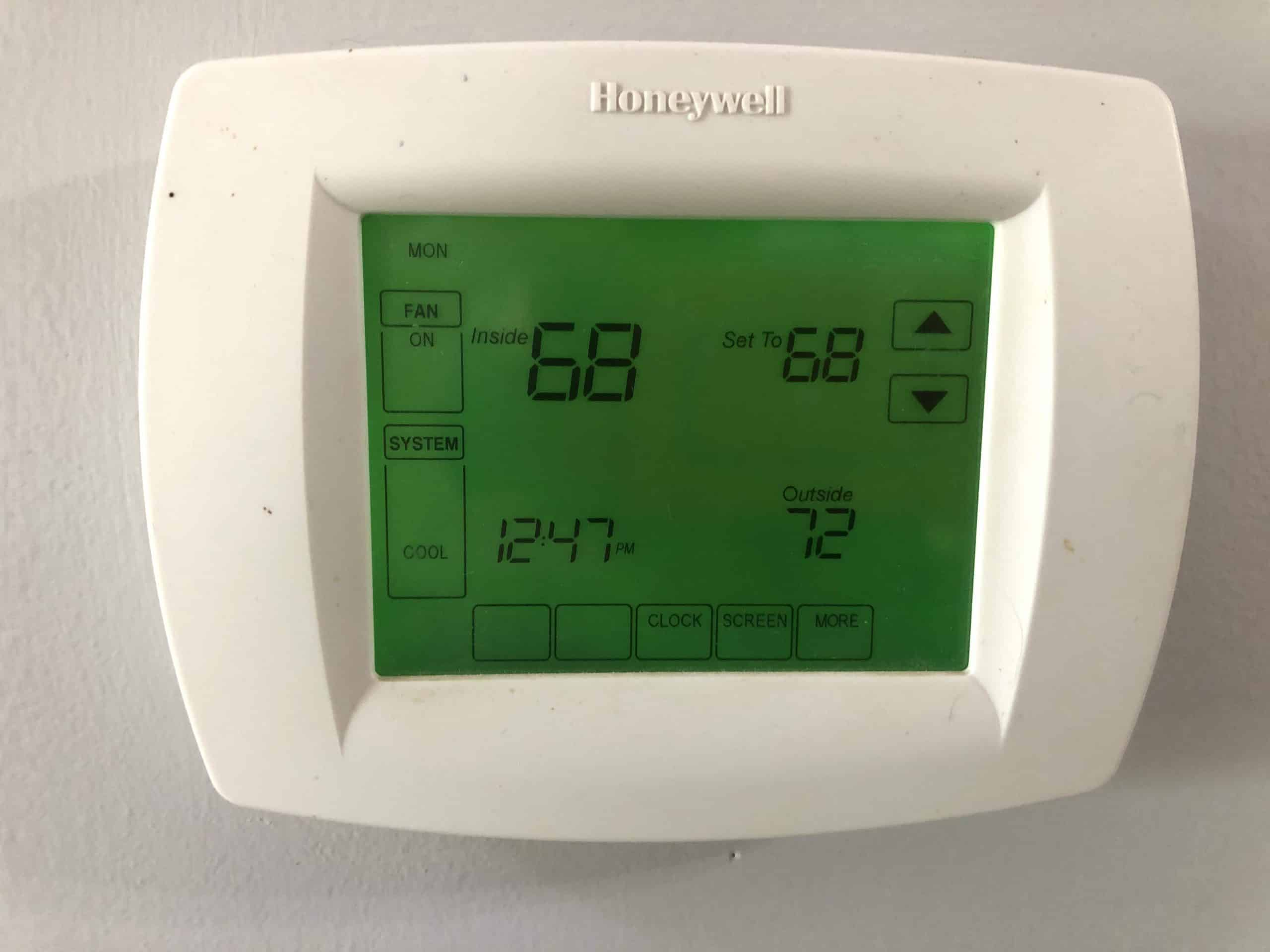 thermostat set to a 68 degrees (F)