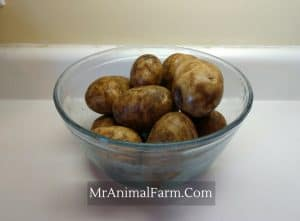 glass bowl of washed potatoes
