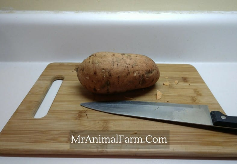 Sweet Potato on  cutting board with large knife