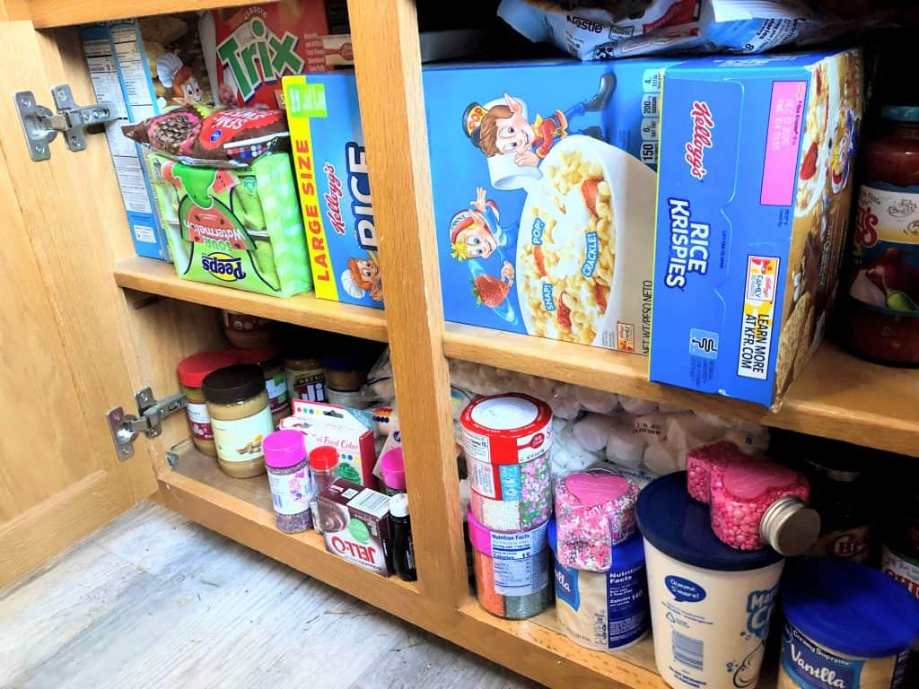 cabinet full of cereal and dessert baking goods