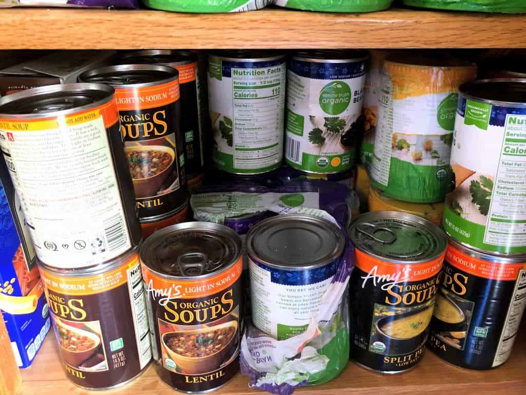 pantry full of canned soup and canned beans