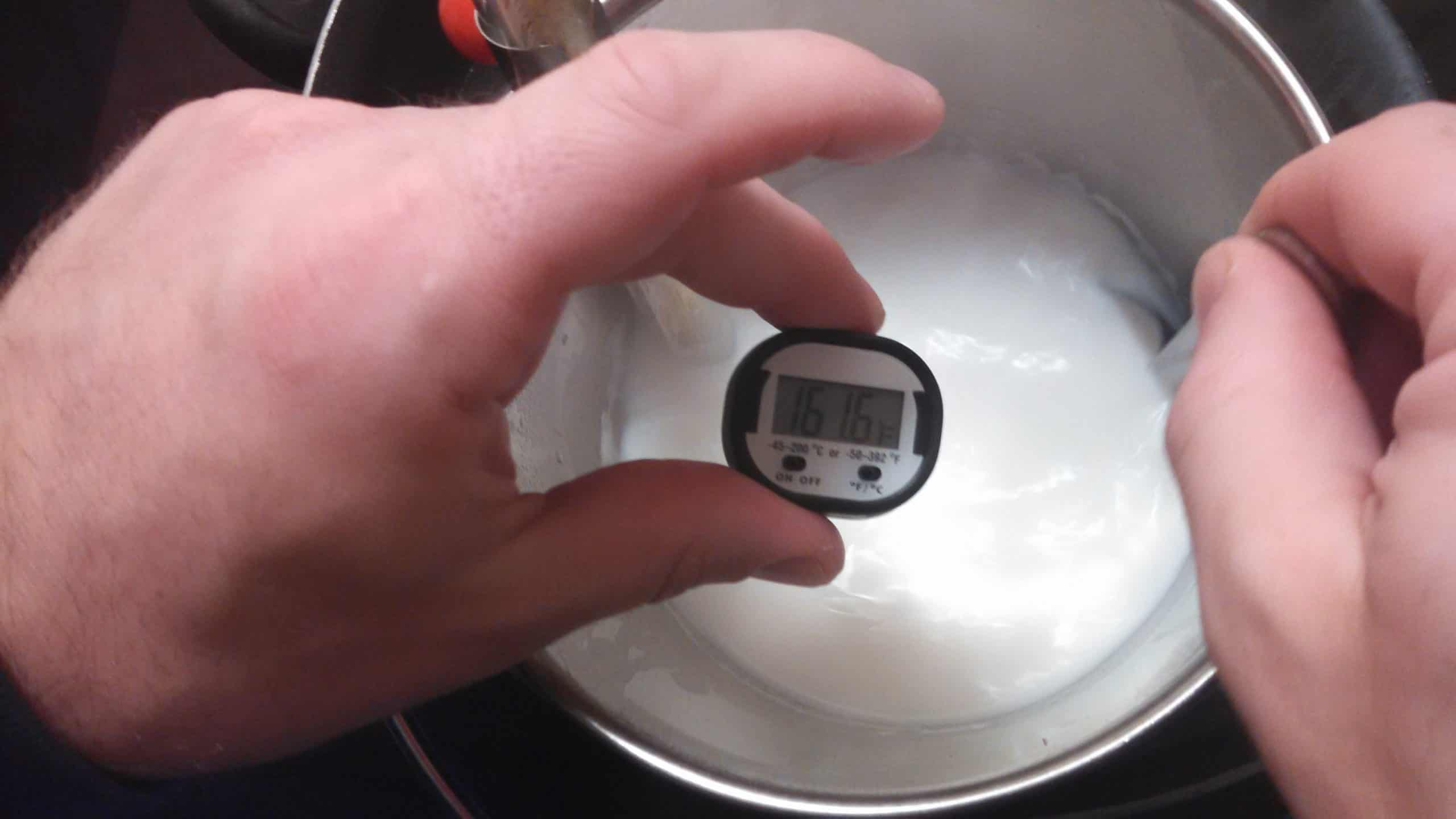 digital thermometer in milk bucket