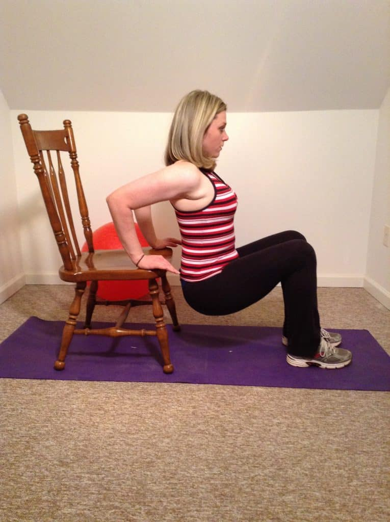 woman doing chair dips