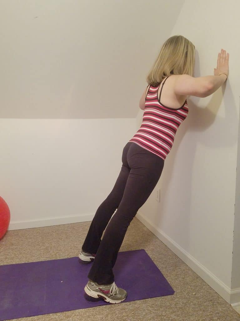 woman doing wall pushups